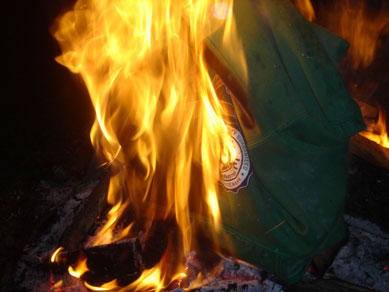 John threw his shirt on the fire, goodbye green hoodie that's exactly like Jake's